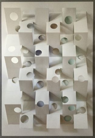 "LIGHT AND VOID, 2016. Cut and folded watercolor paper, flashé, graphite, museum board mounted on archival cardboard. 32 ½"" high, 22"" wide, 3"" deep."